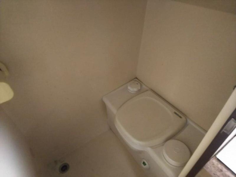 Nissan Atlas Motorhome built in toilet with black water tank